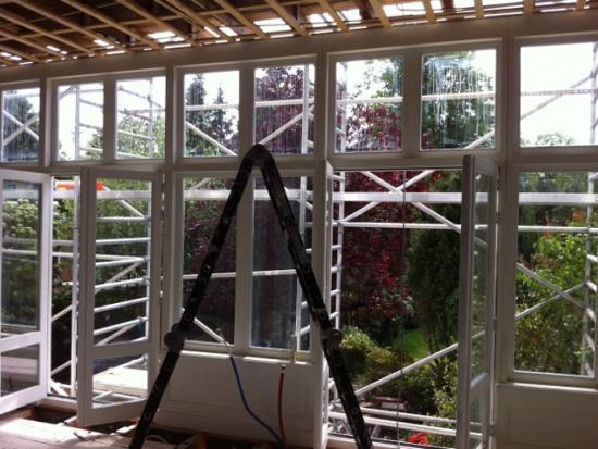Vervangen oude houten kozijnen en houten ramen, isolatieglas, den haag