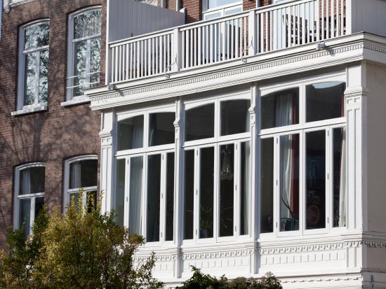 Vervanging van houten ramen, erker, den haag.